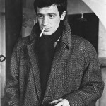 Jean-Paul Belmondo in a tweed coat and scarf combo.
